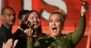 "Adele breaks the Grammy for Record of the Year for ""Hello"" after having it presented to her at the 59th Annual Grammy Awards in Los Angeles, California, U.S., February 12, 2017. REUTERS/Lucy Nicholson"