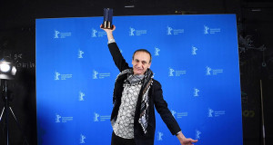 """Palestinian director Raed Andoni poses after being awarded for Best documentary for his film """"Istiyad Ashbah"""" (Ghost Hunting) after the Award Ceremony of the 67th Berlinale film festival in Berlin on February 18, 2017. / AFP PHOTO / POOL / Britta Pedersen"""